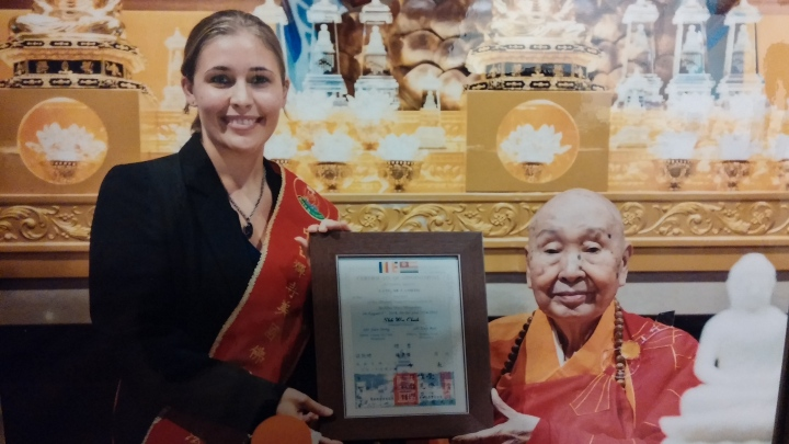 Accepting Dharma Support Association award from Venerable Grand Master Wei Chueh
