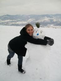 Hugging a snowman at the Millennium Cross in Skopje