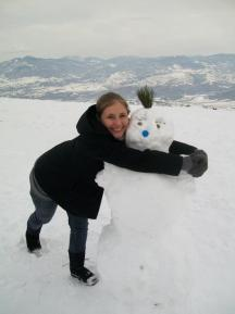 Hugging a snowman at the Millennium Cross in Skopje