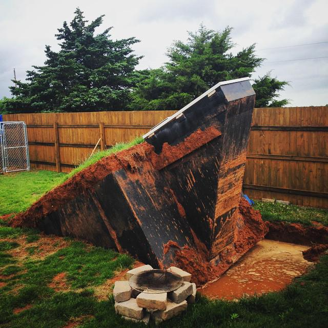 Tornado shelter lifted from underground