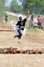 Janelle jumping over fire - Warrior Dash