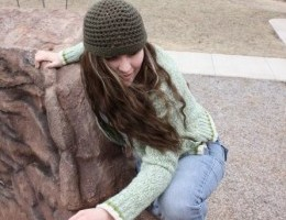 Janelle climbing a rock