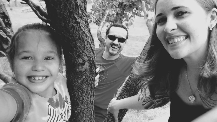 Family fun climbing a tree